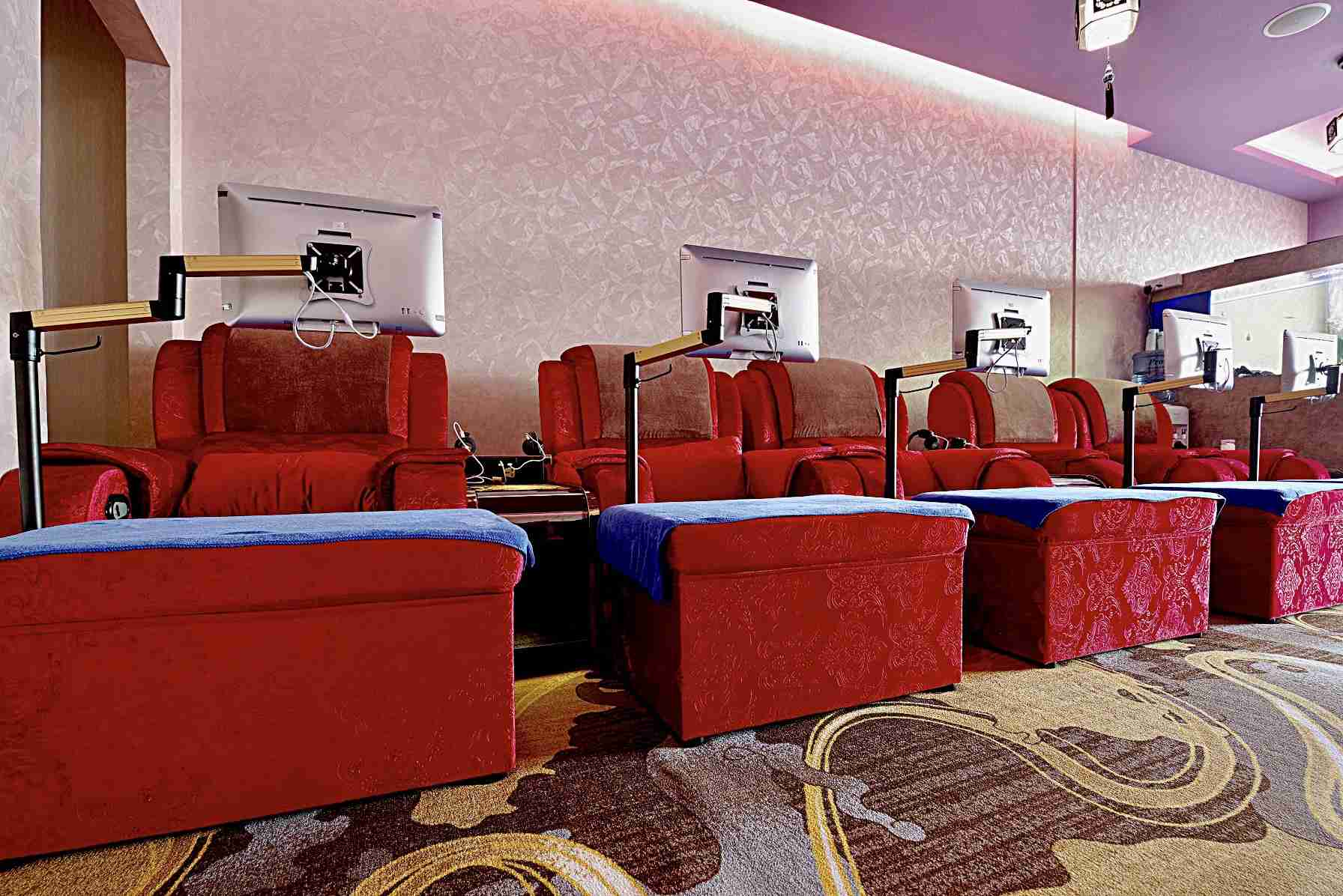 comfy massage chairs with individual screens at Pure Relaxology
